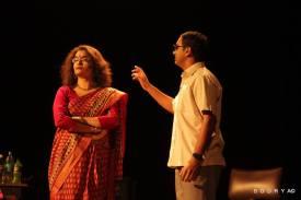 Bhagwan explains his situation to Poonam